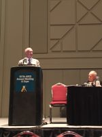 John A. Mackay, Ph.D., left at the podium and Jerry King, Ph.D., on the right