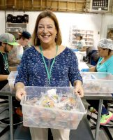 Nancy Whiteman holding a batch of cannabis gummies